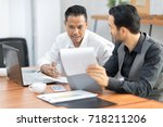 successful team at work. two... | Shutterstock . vector #718211206