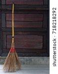 broom lay beside wooden wall... | Shutterstock . vector #718218292