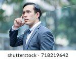 confident businessman in suit... | Shutterstock . vector #718219642