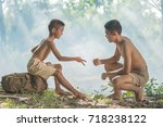 two little boys sitting on a... | Shutterstock . vector #718238122