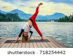 woman doing yoga by the lake      Shutterstock . vector #718254442