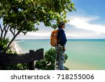 man traveler with backpack and...   Shutterstock . vector #718255006
