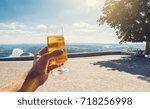 young man drinks fresh beer in...   Shutterstock . vector #718256998