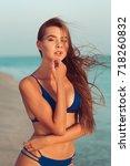 woman in bikini on beach   Shutterstock . vector #718260832