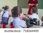 school children are... | Shutterstock . vector #718264405