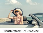 young woman drive a car on the...   Shutterstock . vector #718266922