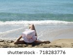 young woman back head in sun...   Shutterstock . vector #718283776