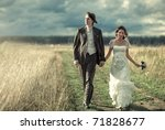 young wedding couple walking on ... | Shutterstock . vector #71828677