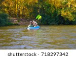 family kayaking  mother and... | Shutterstock . vector #718297342