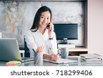 asian businesswoman with... | Shutterstock . vector #718299406