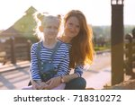 happy family   smiling mother... | Shutterstock . vector #718310272