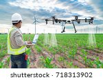 technician farmer use wifi... | Shutterstock . vector #718313902