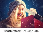 happy young woman opening a... | Shutterstock . vector #718314286
