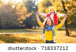 happy family mother and child... | Shutterstock . vector #718337212