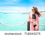 beautiful woman standing on... | Shutterstock . vector #718343275