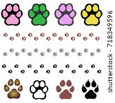 set of dog paw prints. hand... | Shutterstock .eps vector #718349596