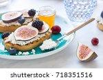 bruschettas with fresh ripe... | Shutterstock . vector #718351516