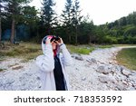 female hiker looking through... | Shutterstock . vector #718353592