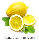 one whole and sliced lemon on... | Shutterstock . vector #718358836
