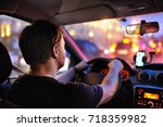 male driver ride a car during... | Shutterstock . vector #718359982