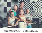 young family is satisfied of... | Shutterstock . vector #718360966
