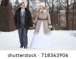 happy and smiling wedding... | Shutterstock . vector #718363906
