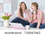mother and daughter singing...   Shutterstock . vector #718367662