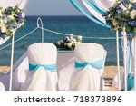 setting up a wedding on the... | Shutterstock . vector #718373896