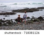 two boys play at the edge of... | Shutterstock . vector #718381126