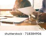 team of business associates... | Shutterstock . vector #718384906