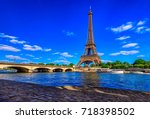 paris eiffel tower and river... | Shutterstock . vector #718398502