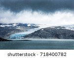 norway glacier with mountains...   Shutterstock . vector #718400782