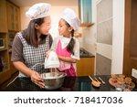 asian mother and daughter enjoy ... | Shutterstock . vector #718417036