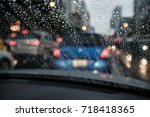 abstract rain droplets on car...   Shutterstock . vector #718418365