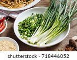 fresh shallots in a bowl | Shutterstock . vector #718446052