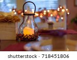 autumn table decor with glowing ... | Shutterstock . vector #718451806