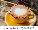 beautiful rose caffe latte | Shutterstock . vector #718452976
