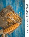 corn on a blue wooden boards ...   Shutterstock . vector #718459462