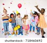 group of kids celebrate... | Shutterstock . vector #718460692