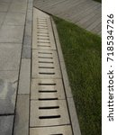Small photo of Road curb and grate