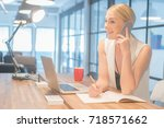 office woman talking to someone ... | Shutterstock . vector #718571662