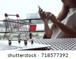 woman and small shopping cart... | Shutterstock . vector #718577392