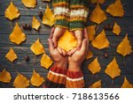 autumn couple holding yellow... | Shutterstock . vector #718613566