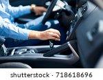 young man is choosing a new... | Shutterstock . vector #718618696