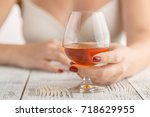 hand  a glass of cognac | Shutterstock . vector #718629955