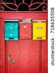 red wooden door with colorful... | Shutterstock . vector #718635508