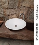 porcelain sink with a tap for... | Shutterstock . vector #718643122