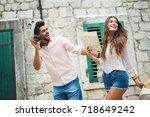 tourist couple enjoying... | Shutterstock . vector #718649242