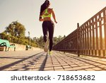 girl athlete runs along the... | Shutterstock . vector #718653682