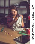 young seamstress making some... | Shutterstock . vector #718672525